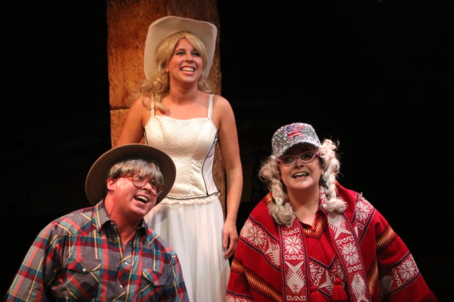 Rob Wall (left) as Milam Lamar, Allison Comotto (center) as Gutrune, and Andrea Bush (right) as Needa Trout