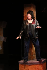 Andrea Bush as Backup Singer in Das Barbecü at Spotlighters Theatre
