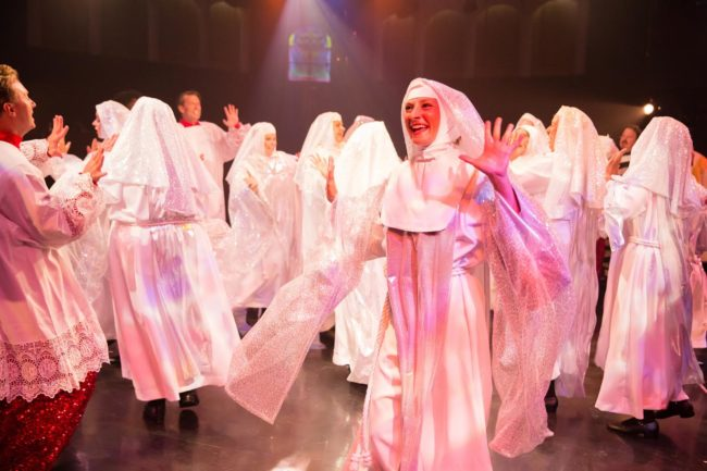 Erica Clare (center) as Sister Mary Rita of the nunsemble in Sister Act at Toby's Dinner Theatre
