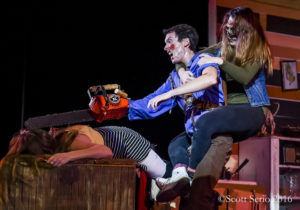 Mike Bliss (center) as Ash fighting off Candarian Demons (L- Stephanie Smith & R- Darby McLaughlin) in Evil Dead: The Musical