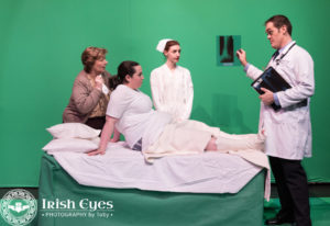 A mother (Anne Hilleary), her injured child (Bridgette Saverine), nurse Jacie (Caity Brown) and Doctor (Stephen T. Wheeler) in a scene from the hospital soap opera.