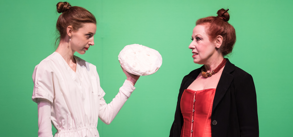 Jacie (Caity Brown) prepares to throw a pie at Carla Pepperbloom (Diane Sams)