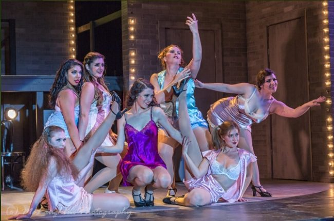 Sarah Jane Bookter (center) as Fraulein Sally Bowles and the Kit Kat Club Girls in Cabaret