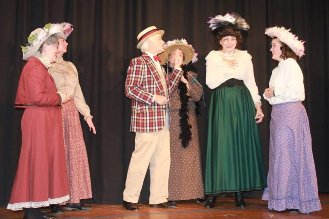 Michael Hulett (center) as Harold Hill and the ladies of River City in Music Man