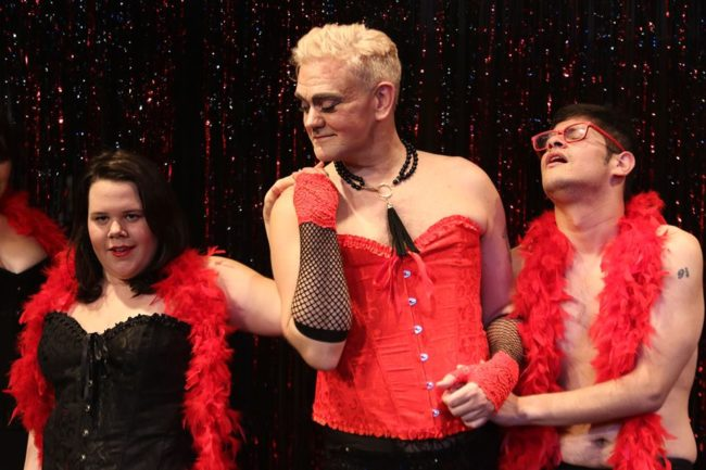 Kristen Demers (left) as Janet Weiss, Peter N. Crews (center) as Frank 'N' Furter and Christian Gonzalez (right) as Brad Majors