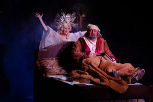 Heather Beck (left) as Ghost of Christmas Past and David Bosley-Reynolds (right) as Scrooge
