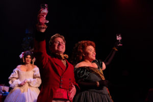 MaryKate Brouillet (left) as Emily with Jeffrey Shankle (center) as Mr. Fezziwig and Crystal Freeman (right) as Mrs. Fezziwig