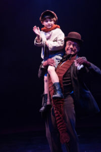 Lucas Bromberg (left) as Tiny Tim and David James (right) as Bob Cratchit