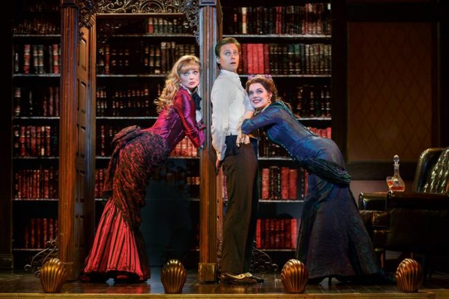 Kristen Beth Williams (left) as Sibella, Kevin Massey (center) as Monty Navarro, and Kristen Hahn (right) as Phoebe D'Ysquith