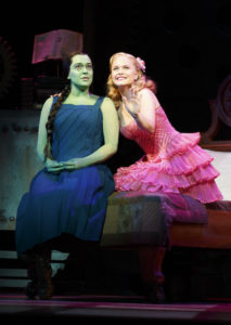 Jessica Vosk (left) as Elphaba and Amanda Jane Cooper (right) as Glinda in Wicked