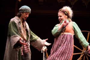 The sheep thief Mak (Ryan Sellers) enjoys a jovial moment with his wife Gill (Tonya Beckman) in the holiday production of The Second Shepherds' Play