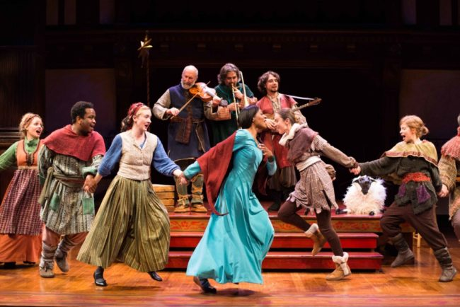The company of the holiday production of The Second Shepherds' Play dances in merry celebration. On stage at Folger Theatre