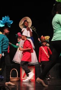 Riyan Ware (center) as Mistress Mary Quite Contrary and her Flowers