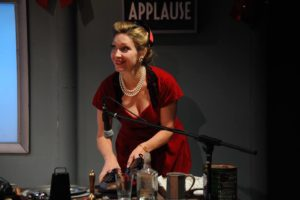 Sally Boyett as Lana Sherwood, operating Foley sound effects in It's a Wonderful Life: A Live Radio Play