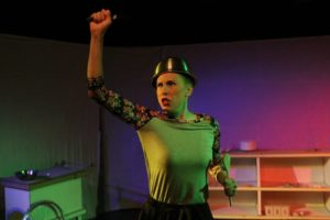 Barbara Madison Hauck as Lulu in Exit Pluto