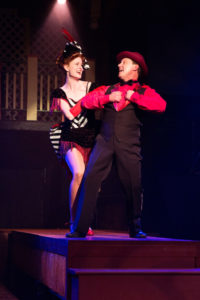 Elizabeth Rayca (left) as Ellie and Jeffrey Shankle (right) as Frank