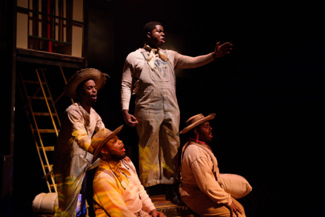 Marquis White (center) as Joe and The Stevedores (Andre Hinds, DeCarlo Raspberry, Anwar Thomas)