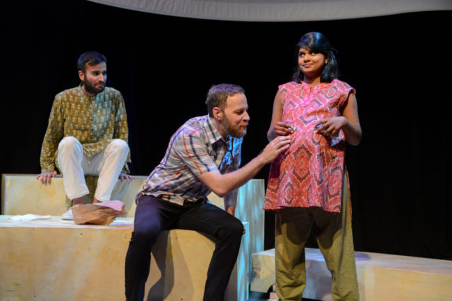 Unborn baby Amit (Utkarsh Rajawat) looks on as Craig (Paul Diem) listens to his heartbeat inside Suraiya (Saraniya Tharmarajah)