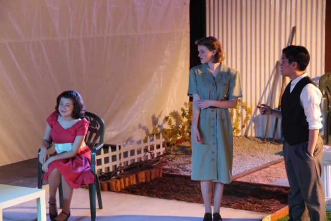 Rachel Sparks (left) as Ann Deever, Sydney Acuff (center) as Sue Bayliss, and Danny Fitz Tran Ho (right) as Dr. Jim Bayliss