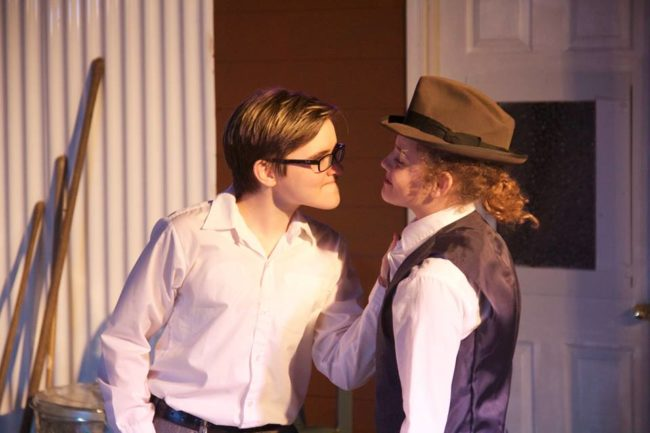 Alex Heywood (left) as Chris Keller and Hellen De Oliveira (right) as George Deever in All My Sons