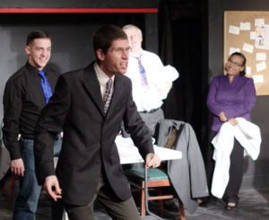 Win Britt (center) as Ira Stone and the cast of Laughter on the 23rd Floor