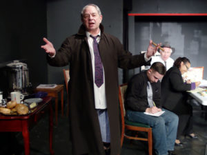 Jeff Murray (center) as Max Price, with the cast of Laughter on the 23rd Floor