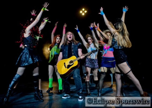 Drew (center- Brandon Zebley) and the Ensemble Girls of Rock Of Ages