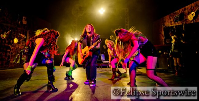 Brandon Zebley (center) as Drew and the ensemble of Rock Of Ages