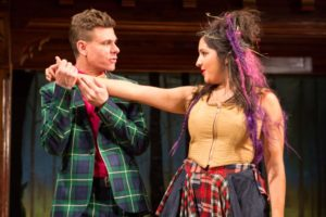 The witty Touchstone (Aaron Krohn) shows off his wooing prowess to Audrey (Kimberly Chatterjee) in Shakespeare's romantic comedy As You Like It.