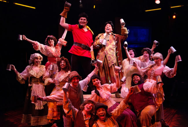 David Jennings (center left) as Gaston and Jeffery Shankle (center right) as Lefou and the ensemble in Beauty & The Beast
