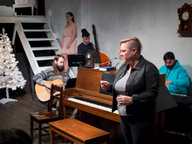 (L to R) Trevor Shipley on guitar, Amber Wood (in rotating rep) as Kathy, Cody Raum on cello, Amanda J. Rife (in rotating rep) as Jamie, and Musical Director Ben Shaver on piano