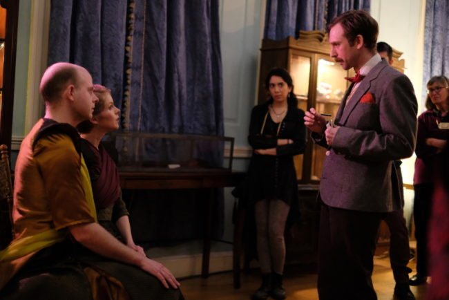 David Brasington (seated left) and Lisi Stoessel (seated right) and Alex Vernon (standing right) in a scene from H.T. Darling's Incredible MUSÆUM