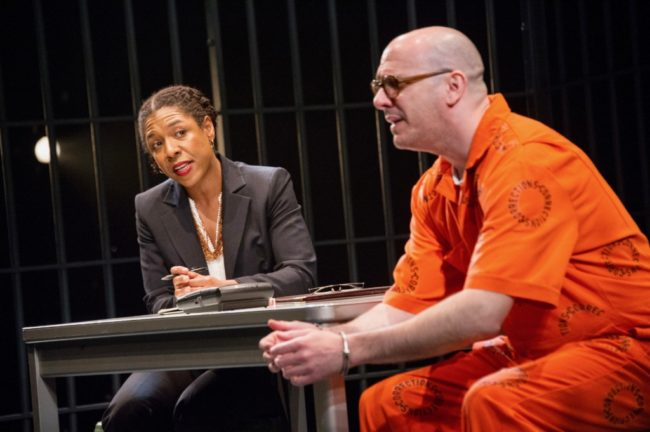 (L to R) Chris Genebach as Eugene de Kock, Jason B. McIntosh as Guard, and Erica Chamblee as Pumla Gobodo-Madikizela in A Human Being Died That Night at Mosaic Theater Company of DC,