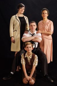 Alicia Sweeney (left) as Luisa, Jason Vellon (center back) as Guido Contini, Jackson Parlante (center front) as Young Guido, and Susan S. Porter (right) as Mama Contini in Nine