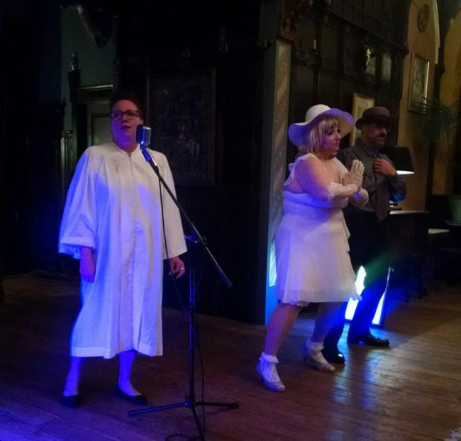 "Reverend Joy Ryde (left) with Tapitha Kix (center) and Brother Covington (right) performing ""Day by Day"" accompanied by (not pictured) Organist Reverend Robin Byrd"