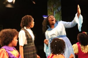 Amber Hooper (left) as Dorothy with Renata Hammond (right) as Addaperle in The Wiz