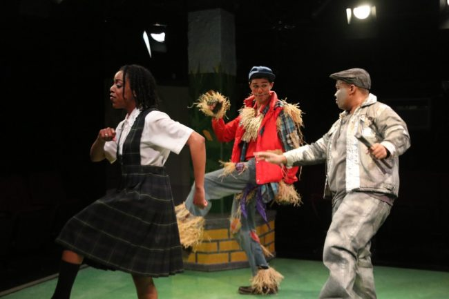 Amber Hooper (left) as Dorothy, Justin Johnson (center) as Scarecrow, and Shae Henry (right) as TinMan in The Wiz