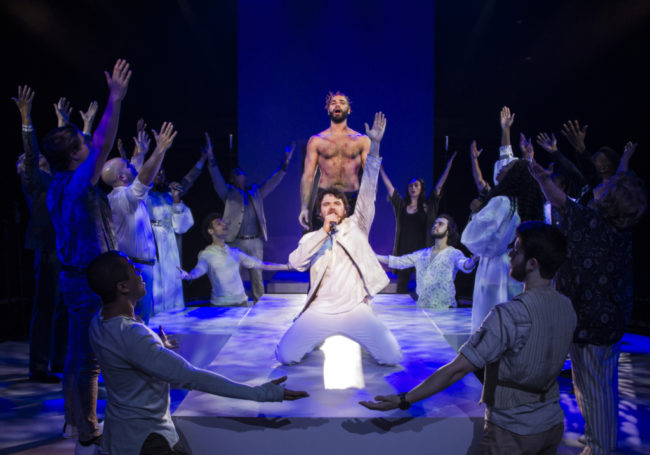 Nicholas Edwards (Jesus) and Ari McKay Wilford (Judas) with the cast of Jesus Christ Superstar at Signature Theatre