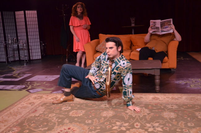 Lee Conderacci (back left) as Avril, Matthew Lindsay Payne (front center) as George and Zack Jackson (blended into the couch) as Tony in Voices in the Rubble