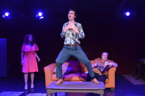 Lee Conderacci (left) as Avril, Matthew Lindsay Payne (center) as George and Zack Johnson (on couch) as Tony in Voices in the Rubble