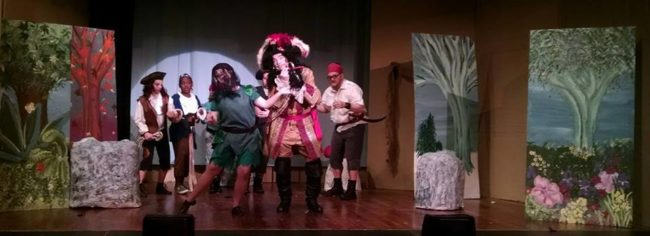 Ashley Gerhardt (center left) as Peter Pan and John Dignam (center right) as Captain Hook