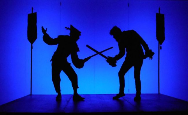 Jon Kevin Lazarus (left) as Robin Hood and Derek Vaughn Brown (right) as Sheriff of Nottingham with Lighting Design by Helen Garcia-Alton