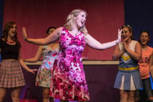 Clare Kneebone (center) as Elle Woods