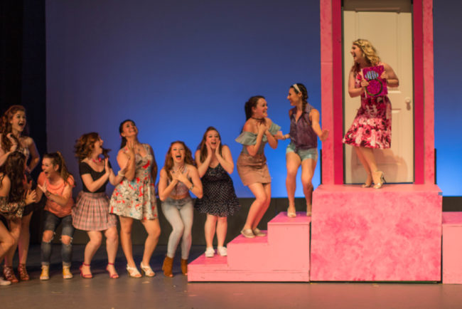 Clare Kneebone (far right) as Elle Woods and the Daughters of Delta Nu