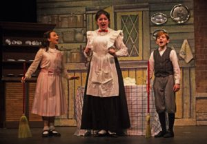 Sophia Riazi-Sekowski (left) as Jane Banks, Emily Mudd (center) as Mary Poppins, and Nathaniel Burkhead (right) as Michael Banks