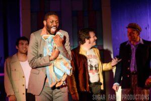 Theodore Sapp (center) as Curtis