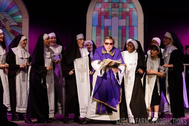 Greg Jones Ellis (center) as Monsignor O'Hara and the nuns of Sister Act