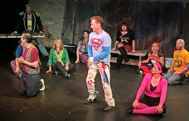 John Andrew Rose (center) as Jesus and the ensemble of Godspell