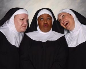 Rikki Howie Lacewell (center) as Deloris Van Cartier in guise as Sister Mary Clarence with the Sisters of Sister Act