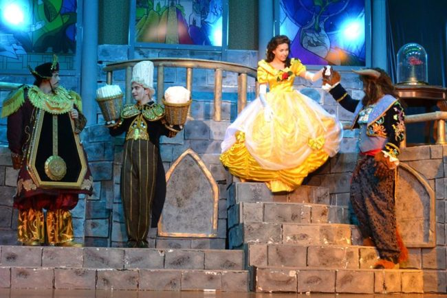 (L to R) Cameron Casey as Cogsworth, Henry Cyr as Lumiere, Ilyssa Rubin as Belle, and Tom Zepp as The Beast